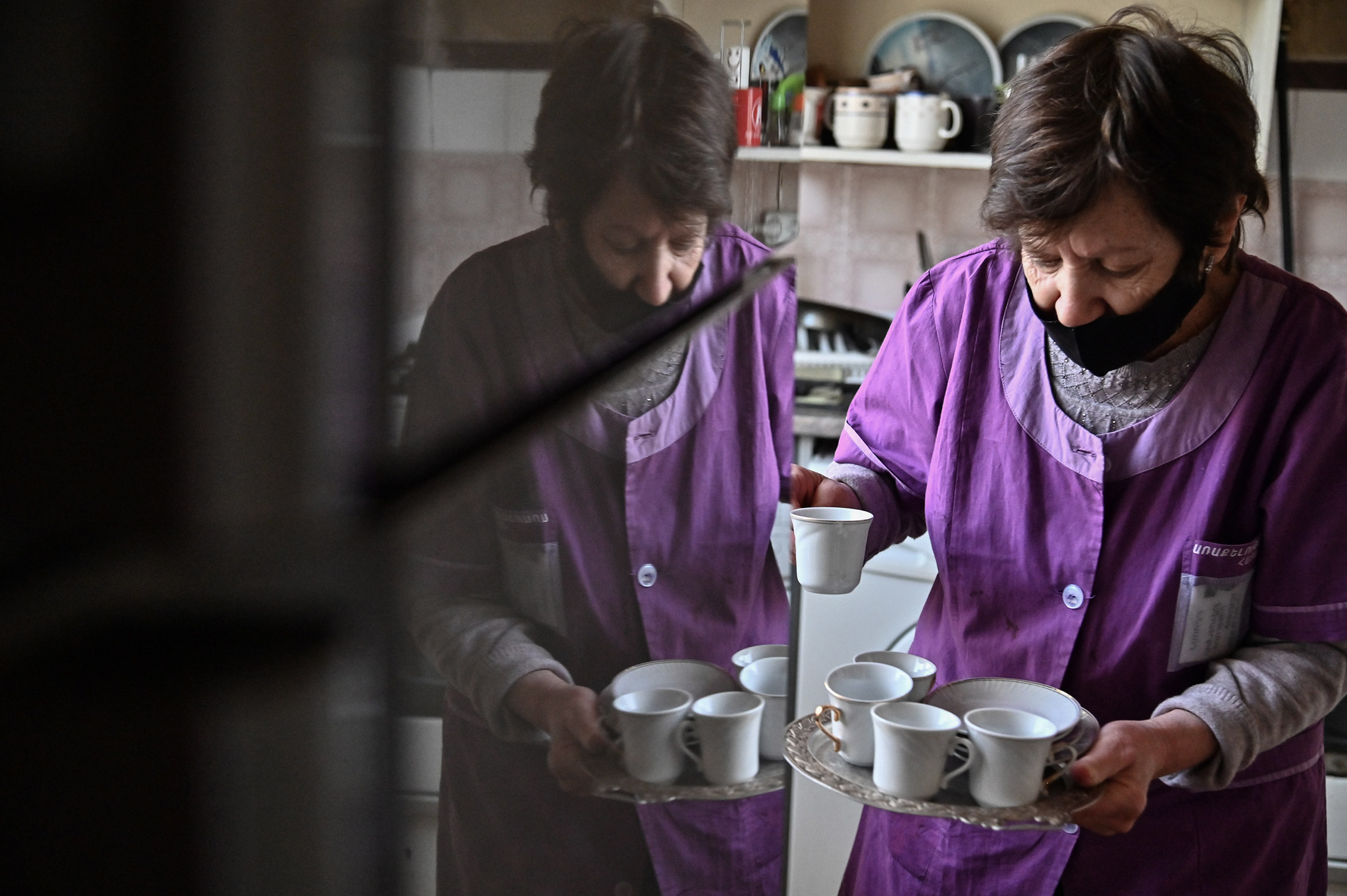 Sveta prepares coffee at Alice's house. She has been caring for Alice for 26 years, since she starte ...
