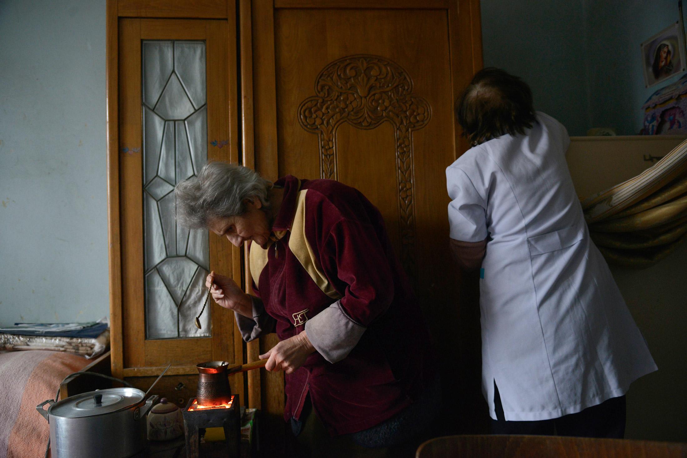 Julia Khachaturova prepares a modest treat while Sveta works.