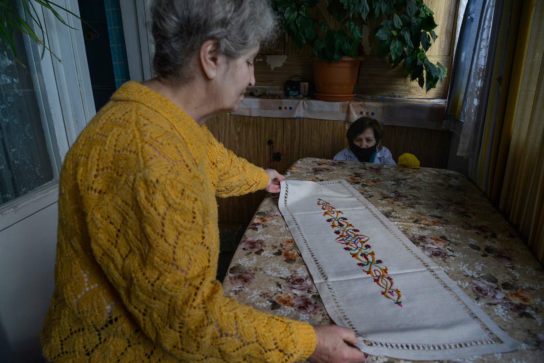 Margo Avetyan shows a tablecloth she embroidered. Several years ago, she started to sell her embroid ...