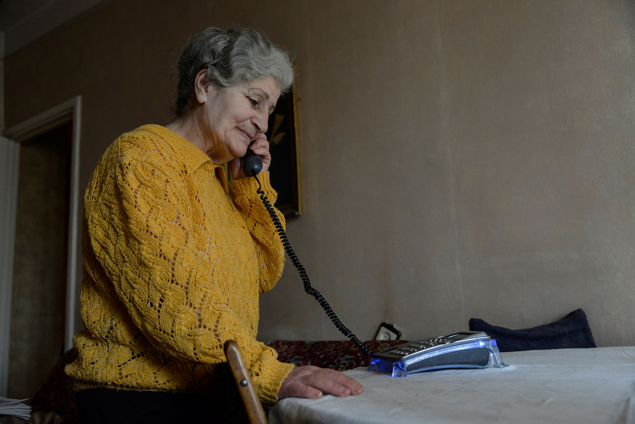 Margo Avetyan, 71, talks to her sister on the phone while Sveta completes her tasks. She helps clien ...