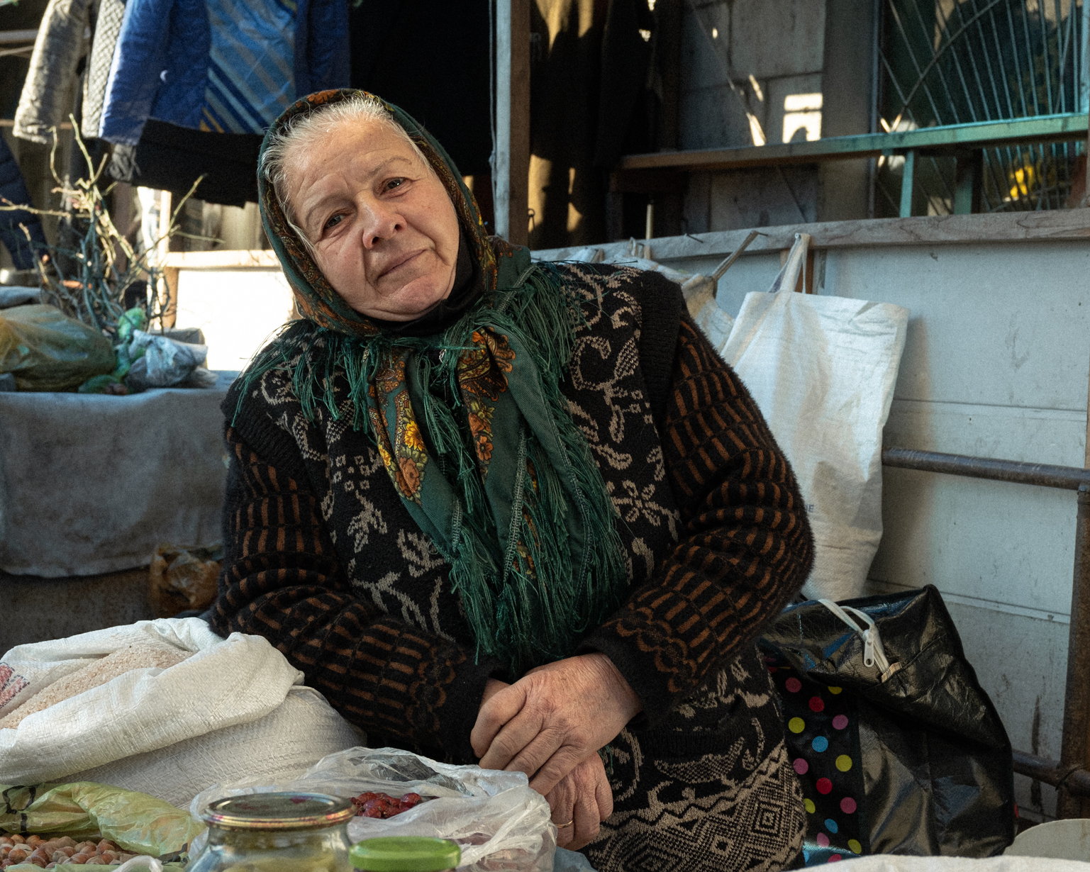 Letafet, 61, sells different goods, from the crops she grows in her garden to rice, at the bazaar. S ...