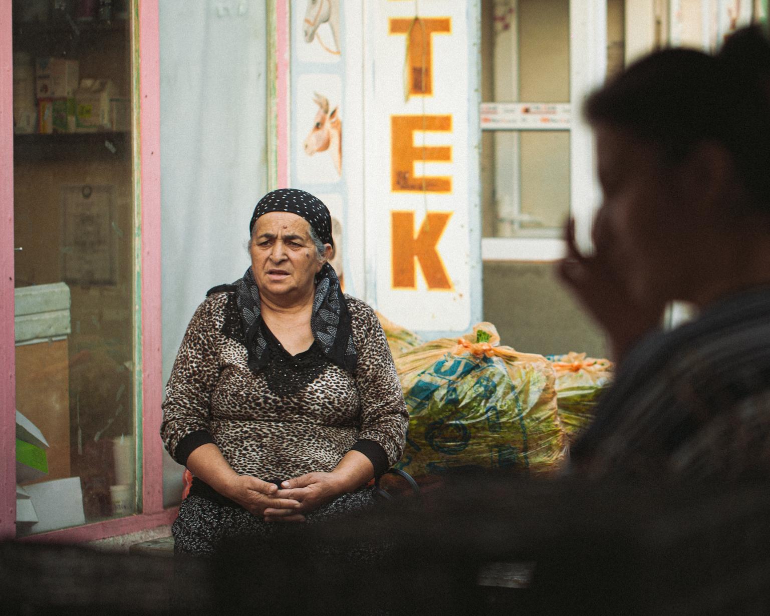 A trader rests at Taza Bazaar. Shaki, 2015