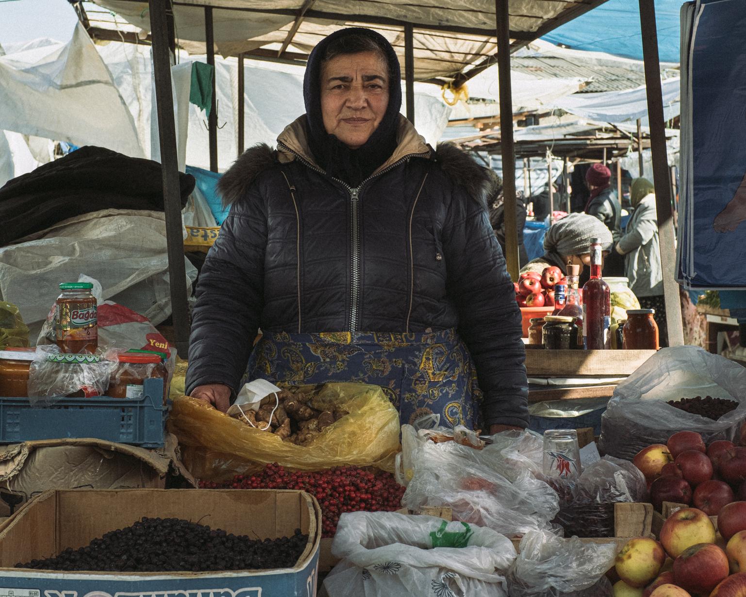 Rafiga, 65, sells mixed goods at the bazaar. Shaki, 2021